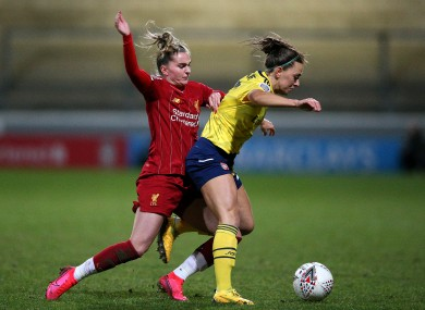 Liverpool's Melissa Lawley (left) and Arsenal's Katie McCabe (right) battle for the ball.