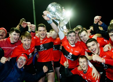 UCC players celebrate their Fitzgibbon Cup success.