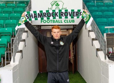 Holding up the Rovers scarf.