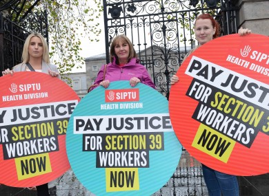Siptu members Liz Cloherty, Maria Power and Stephanie Lee calling on Government to give Section 39 workers' pay justice outside Leinster House in 2017