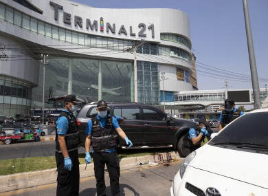 Forensic officers inspect shooting victim's vehicle outside Terminal 21 Korat mall in Nakhon Ratchasima, Thailand