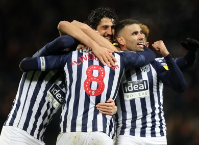 West Brom players celebrate their second goal.