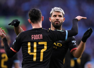 Manchester City's Sergio Aguero (right) celebrates scoring his side's first goal of the game.