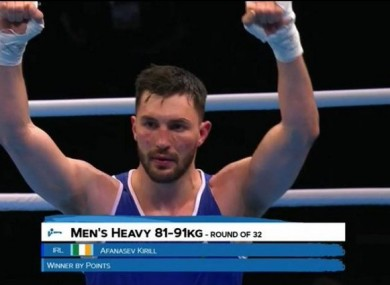 Ireland's Kiril Afanasev celebrates progression to the last 16 at heavyweight.