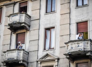 People singing on their balconies in Milan during coronavirus lockdown.