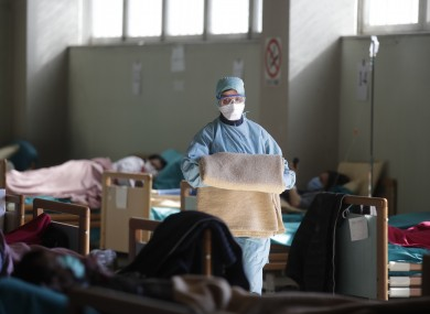 Medical staff work at one of the emergency structures that were set up to ease procedures at the Brescia hospital, northern Italy.