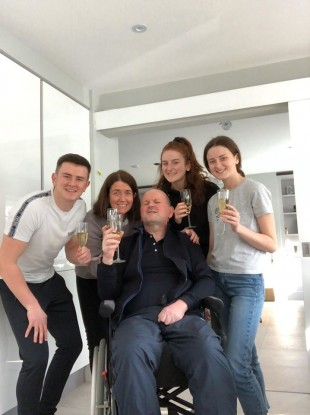 Sean at home with his family.
