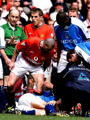 Roy Keane stands over a prone Alf Inge Haaland.