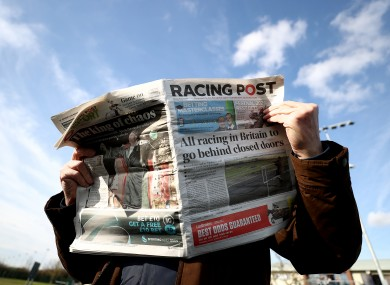 The Racing Post is read at a meeting of Southwell Races last week.