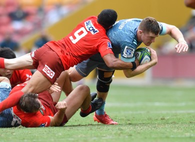 Dallas McLeod of the Crusaders is tackled by Rudy Paige of the Sunwolves.