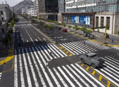 An armored vehicle guards an intersection on Abancay avenue, after the government implemented restrictions to prevent the spread of the new coronavirus in Lima, Peru.