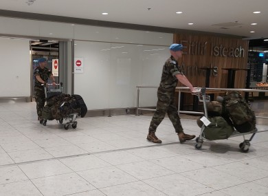 Members of the Defence Forces in Dublin Airport yesterday.