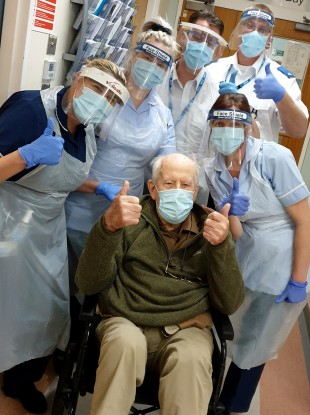Keith Watson and some of the medical staff who looked after him in hospital.