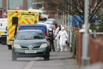 PSNI forensic officers at the scene of the shooting in north Belfast this morning
