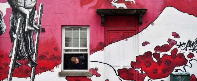 A man peers out of his window in Bristol as the UK enters the second week of lockdown.