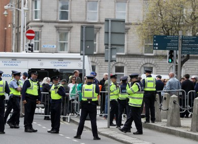Members of gardaí and supporters of Gemma O'Doherty and John Waters.