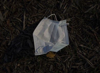 A discarded mask on the ground. Don't do this.