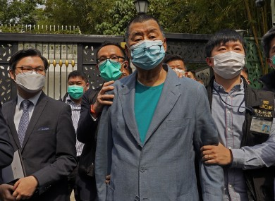 Hong Kong media tycoon Jimmy Lai, center, was arrested on Saturday.