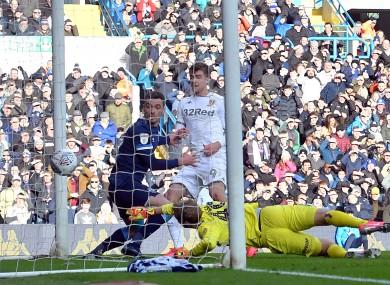 Patrick Bamford of Leeds scores against Huddersfield.