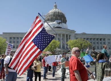 People gather outside the Missouri Capitol to protest stay-at-home orders put into place due to the Covid-19 outbreak.