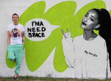 Irish artist Emmalene Blake with her mural of Ariana Grande in South Dublin