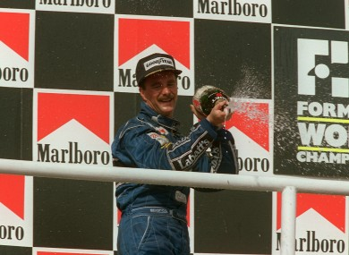 Nigel Mansell celebrates winning the World Championship in 1992.