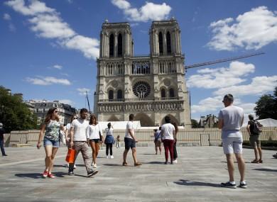 People walk on the forecourt of Notre-Dame's cathedral.