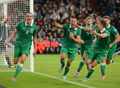 O'Shea celebrates his last-minute equaliser against Germany on his 100th cap.