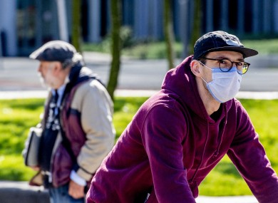 A cyclist wears a face mask in Rotterdam, Netherlands.