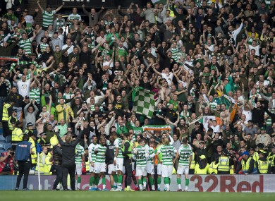 Celtic players and their fans (file photo)
