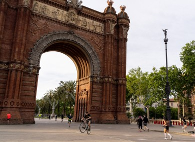 People do exercises at the Arco de Triunfo in Barcelona, Spain.