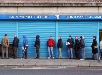 People queue outside a social welfare office in Dublin during the last crisis in 2009