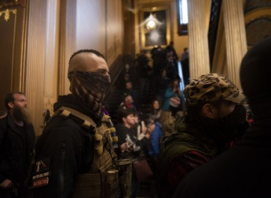 Protesters congregate inside the Capitol Building in Michigan.