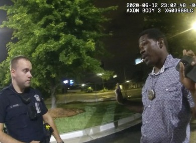 This screen grab taken from body camera video provided by the Atlanta Police Department shows Rayshard Brooks speaking with Officer Garrett Rolfe in the parking lot of a Wendy's restaurant