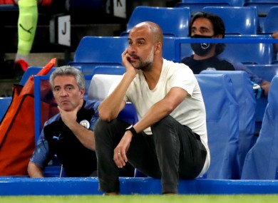 Pep Guardiola looks on as his side slips to defeat at Chelsea.