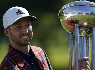 Daniel Berger poses with the championship trophy.