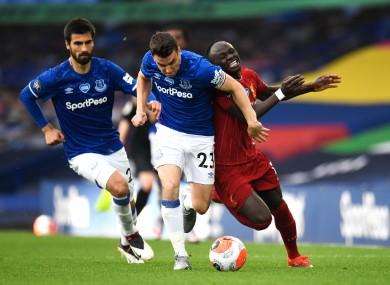 Seamus Coleman challenges Sadio Mane.