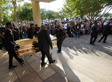 The casket of George Floyd is removed after a public visitation for Floyd at the Fountain of Praise church in Houston.
