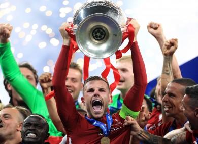 Jordan Henderson lifts the Champions League last season.