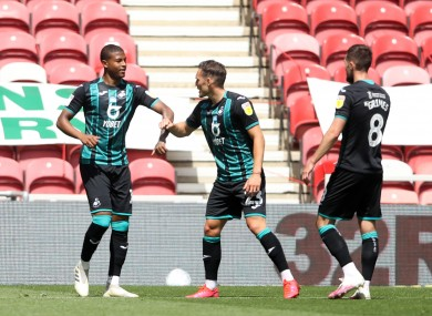 Swansea City's Rhian Brewster (left) celebrates scoring his side's first goal of the game.