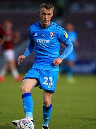 Jake Doyle-Hayes in possession for Cheltenham Town during this evening's play-off.