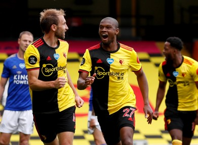 Watford's Craig Dawson (left) celebrates scoring his side's first goal of the game.