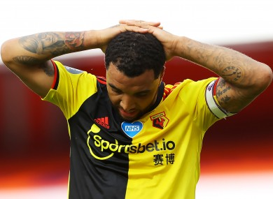 A dejected Troy Deeney contends with Watford's relegation.