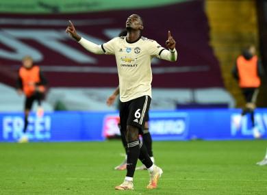 Pogba celebrates scoring his side's third goal last night.