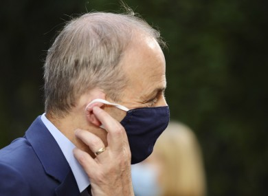 Micheal Martin adjusts his protective as he arrives at yesterday's summit