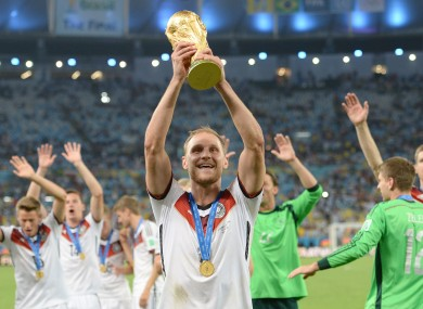 Benedikt Hoewedes pictured with the World Cup trophy in 2014.