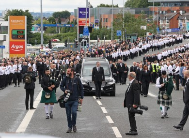 The funeral procession of senior republican Bobby Storey following the funeral at St Agnes' Church in west Belfast