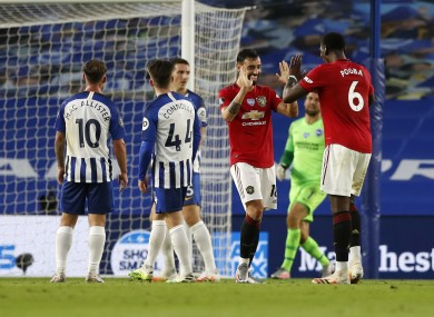 Bruno Fernandes celebrates scoring United's second goal with Paul Pogba.