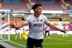 John Egan celebrates after scoring for Sheffield United.