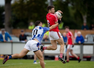 Chris Barrett fetches the ball under pressure from Colm Basquel.